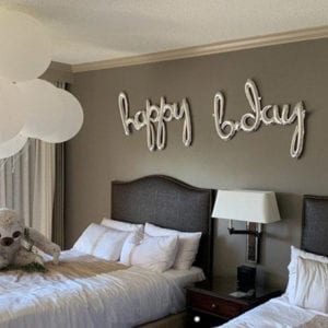Cursive script Happy Birthday silver foil balloon banner